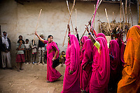 47 year old Sampat Pal Devi, founder and leader of the 10,000 strong Gulabi Gang, leads a group of women on a march through Banda. In the badlands of Bundelkhand, one of the poorest parts of one of India's most populous states, a gang of female vigilantes have sprung up to fight the oppression of a caste-ridden, feudalistic and male dominated society. In a land where dowry demands and domestic and sexual violence are common, the 'Gulabi Gang' (Pink Gang), so called for their uniform of shocking pink saris, are picking up their lathis (traditional Indian sticks) to fight against corruption and violence against women.