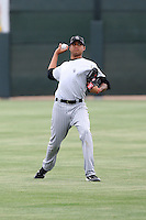 Peter Tago #56 of the Colorado Rockies pitches in an intrasquad extended spring training game at the Rockies minor league complex on April 23, 2011 in Scottsdale, Arizona. .Photo by:  Bill Mitchell/Four Seam Images.