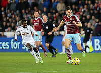 Pictured L-R: Nathan Dyer of Swansea against Stewart Downing of West Ham Saturday 10 January 2015<br /> Re: Barclays Premier League, Swansea City FC v West Ham United at the Liberty Stadium, south Wales, UK