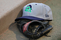 Beloit Snappers hat and glove sit on a step in the dugout during a game against the Kane County Cougars at Fifth Third Bank Ballpark on June 26, 2012 in Geneva, Illinois. Beloit defeated Kane County 8-0. (Brace Hemmelgarn/Four Seam Images)