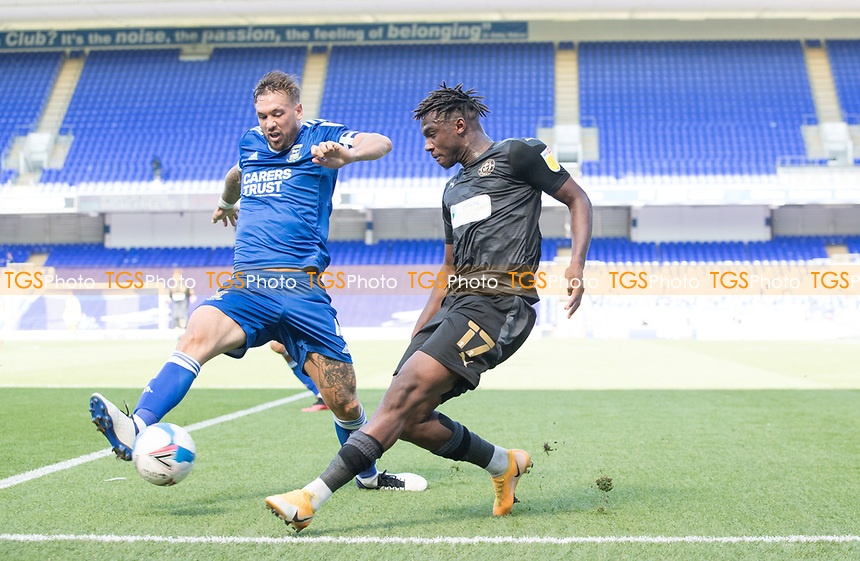 Viv Solomon-Otabor, Wigan Athletic,  cross is blocked by Luke Chambers of Ipswich Town during Ipswich Town vs Wigan Athletic, Sky Bet EFL League 1 Football at Portman Road on 13th September 2020