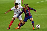 4th October 2020; Camp Nou, Barcelona, Catalonia, Spain; La Liga Football, Barcelona versus Sevilla; Griezmann holds off the challenge from Acuña of Sevilla