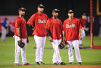 Apr. 11, 2009; Phoenix, AZ, USA; Arizona Diamondbacks players (from left) outfielder Chris Young , first baseman Tony Clark , outfielder Justin Upton and second baseman Felipe Lopez during batting practice prior to the game against the Los Angeles Dodgers at Chase Field. Mandatory Credit: Mark J. Rebilas-