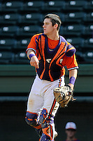 Catcher Chris Okey (25) of the Clemson Tigers in a fall Orange & Purple intrasquad scrimmage on November 2, 2013, at Fluor Field at the West End in Greenville, South Carolina. Orange won 7-1.(Tom Priddy/Four Seam Images)