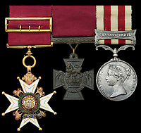 BNPS.co.uk (01202) 558833. <br /> Pic: Spink&Son/BNPS<br /> <br /> Pictured: The medal set awarded to General James Blair including his Victoria Cross, centre. <br /> <br /> The prestigious Victoria Cross awarded to a fearless general who charged the enemy holding just the butt of his sword has sold for £223,000.<br /> <br /> General James Blair was left grasping the blunt hilt of his weapon after damaging its blade 'against the head' of a rebel during a bloody Indian Mutiny skirmish.<br /> <br /> But, despite having no way to protect himself, he ran in front of his men towards the mutineers to engage them in fierce hand-to-hand combat. The defenceless general, who already had a serious slash wound to his right arm, miraculously came out on top, forcing his adversaries to run away.