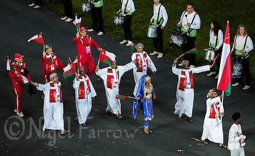 27 JUL 2012 - LONDON, GBR - Shooting competitor Ahmed Al-Hatmi (OMN) leads the team from Oman around the Olympic Stadium during the Opening Ceremony of the London 2012 Olympic Games in Stratford, London, Great Britain (PHOTO (C) 2012 NIGEL FARROW)