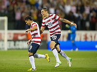 Columbus, Ohio - Tuesday, September 11, 2012: The USA defeated Jamaica 1-0 in the first round of World Cup Qualifying at Columbus Crew Stadium. Herculez Gomez celebrates his goal with Geoff Cameron.
