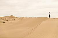 A man looks at the horizon in the sand dunes of the Samalayuca Desert, Chihuahua Mexico. 52 km south of Ciudad Juárez in the middle of the desert area known as the Médanos de Samalayuca. This tourist and travel destination belongs to the Municipality of Ciudad Juárez in northern Mexico.<br /> (Photo: L<br /> <br /> un hombre mira el horizonte en las dunas de arena del desierto de Samalayuca, Chihuahua Mexico. A 52 km al sur de Ciudad Juárez en medio de la zona desértica conocida como los Médanos de Samalayuca. Este destino turístico y de viajes pertenece al Municipio de Ciudad Juárez en el norte de Mexico. <br /> (Foto: LuisGutierrez/NortePhoto)