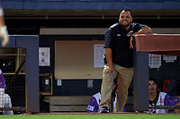 """Akron RubberDucks Athletic trainer Bobby Ruiz during an Eastern League game against the Erie SeaWolves on August 30, 2019 at Canal Park in Akron, Ohio.  Akron wore special jerseys with the slogan """"Fight Like a Kid"""" during the game for Akron Children's Hospital Home Run for Life event, the design was created by 11 year old Macy Carmichael.  Erie defeated Akron 3-2.  (Mike Janes/Four Seam Images)"""