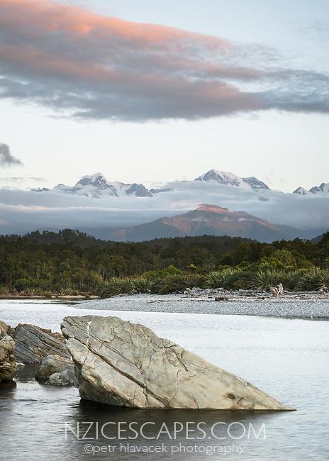 Dusk over highest peaks of Southern Alps, Mount Tasman 3497m on left, Aoraki Mt. Cook 3724m on right, Westland Tai Poutini National Park, West Coast, UNESCO World Heritage, New Zealand, NZ