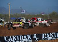 Apr 16, 2011; Surprise, AZ USA; LOORRS driver Kyle Leduc (99) leads Rodrigo Ampudia (36) during round 3 at Speedworld Off Road Park. Mandatory Credit: Mark J. Rebilas-.