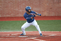 Justin Guy (1) of the Wingate Bulldogs squares to bunt against the Concord Mountain Lions at Ron Christopher Stadium on February 1, 2020 in Wingate, North Carolina. The Bulldogs defeated the Mountain Lions 8-0 in game one of a doubleheader. (Brian Westerholt/Four Seam Images)