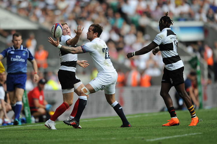 Danny Cipriani of England juggles the ball with Chris Ashton (Toulon & England) of Barbarians during the Quilter Cup match between England and Barbarians at Twickenham Stadium on Sunday 27th May 2018 (Photo by Rob Munro/Stewart Communications)