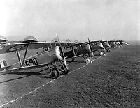 Twenty-six aeroplanes in line for insepction, aviation field, Issoudon, France.  April 1918. (Army)<br /> Exact Date Shot Unknown<br /> NARA FILE #:  111-SC-10302<br /> WAR & CONFLICT BOOK #:  590