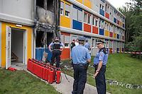 Brandanschlag auf Fluechtlingsunterkunft in Berlin-Buch.<br /> Am Montag den 8. August 2016 veruebten Unbekannte gegen 3.00 Uhr einen Brandanschlag auf eine Fluechtlingsunterkunft in Berlin-Buch. Sie warfen einen Molotowcoctail durch ein Fenster in das Haus und setzten das Gebaeude in Brand. Die Flammen schlugen bis in den zweiten Stock des Wohncontainers. Die Bewohner retteten schlafende Bewohner aus den oberen Stockwerken und <br /> loeschten den Brand selber mit Feuerloeschern bevor Feuerwehr und die Polizei kamen. Nach Angaben von Bewohnern muessen jetzt wahrscheinlich 180 Menschen aus den Wohncontainern ausziehen, da die Elektrik durch den Brand schwer beschaedigt wurde.<br /> 8.8.2016, Berlin<br /> Copyright: Christian-Ditsch.de<br /> [Inhaltsveraendernde Manipulation des Fotos nur nach ausdruecklicher Genehmigung des Fotografen. Vereinbarungen ueber Abtretung von Persoenlichkeitsrechten/Model Release der abgebildeten Person/Personen liegen nicht vor. NO MODEL RELEASE! Nur fuer Redaktionelle Zwecke. Don't publish without copyright Christian-Ditsch.de, Veroeffentlichung nur mit Fotografennennung, sowie gegen Honorar, MwSt. und Beleg. Konto: I N G - D i B a, IBAN DE58500105175400192269, BIC INGDDEFFXXX, Kontakt: post@christian-ditsch.de<br /> Bei der Bearbeitung der Dateiinformationen darf die Urheberkennzeichnung in den EXIF- und  IPTC-Daten nicht entfernt werden, diese sind in digitalen Medien nach §95c UrhG rechtlich geschuetzt. Der Urhebervermerk wird gemaess §13 UrhG verlangt.]