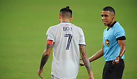WASHINGTON, DC - AUGUST 25: Gustavo Bou #7 of New England Revolution with referee Guido Gonzales Jr during a game between New England Revolution and D.C. United at Audi Field on August 25, 2020 in Washington, DC.