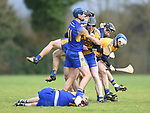 Sixmilebridge and Newmarket players exchange views during their Clare Champion Cup final at Clonlara. Photograph by John Kelly.