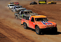 Apr 17, 2011; Surprise, AZ USA; LOORRS driver Adrian Cenni (11) leads Rick Huseman (36) during round 4 at Speedworld Off Road Park. Mandatory Credit: Mark J. Rebilas-