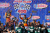 Martin Truex Jr., Furniture Row Racing, Toyota Camry Bass Pro Shops/5-hour ENERGY celebrates his win in victory lane