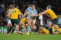 Joaquin Tuculet of Argentina is tackled by David Pocock of Australia as Israel Folau of Australia supports during the Semi Final of the Rugby World Cup 2015 between Argentina and Australia - 25/10/2015 - Twickenham Stadium, London<br /> Mandatory Credit: Rob Munro/Stewart Communications
