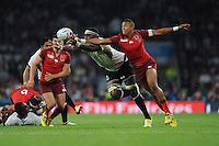 Anthony Watson of England and Apisalome Ratuniyarawa of Fiji during Match 1 of the Rugby World Cup 2015 between England and Fiji - 18/09/2015 - Twickenham Stadium, London <br /> Mandatory Credit: Rob Munro/Stewart Communications