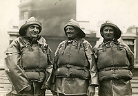 BNPS.co.uk (01202 558833)<br /> Pic: CentralNews/BNPS<br /> <br /> Gallantry medalliist's pose for a portrait in 1925 - l-r Thomas Patton, Andrew Tose and Richard Payne all received Bronze medals.<br /> <br /> Splash in the Attic...<br /> <br /> A 'lost' cache of 13,000 photographs charting the history of the RNLI has been found in the attic of the charity's headquarters.<br /> <br /> Many of the black and white photos date back to the 1920s and '30s long before the terms 'health and safety' and 'risk assessment' were thought of.<br /> <br /> One image depicts a brave lifeboatman dressed in a suit and cloth cap just as the lifeboat he is on launches down a ramp into a choppy sea.<br /> <br /> Another shows the crew of another open lifeboat getting swamped by waves with only their souwesters and lifejackets to protect them.<br /> <br /> The photos have been unearthed in storage space at the RNLI HQ in Poole, Dorset, and they are now being digitised.