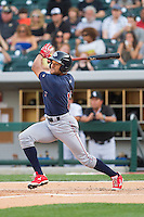 Tyson Gillies (13) of the Lehigh Valley IronPigs follows through on his swing against the Charlotte Knights at BB&T Ballpark on May 8, 2014 in Charlotte, North Carolina.  The IronPigs defeated the Knights 8-6.  (Brian Westerholt/Four Seam Images)