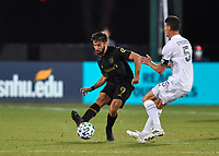 LAKE BUENA VISTA, FL - JULY 18: Diego Rossi #9 of LAFC passes the ball while pressured by Daniel Steres #5 of LA Galaxy during a game between Los Angeles Galaxy and Los Angeles FC at ESPN Wide World of Sports on July 18, 2020 in Lake Buena Vista, Florida.
