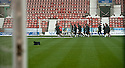 THE DUNFERMLINE PLAYERS TRAIN ON THE PITCH AFTER REFEREE BOBBY MADDEN CALLED THE GAME OFF