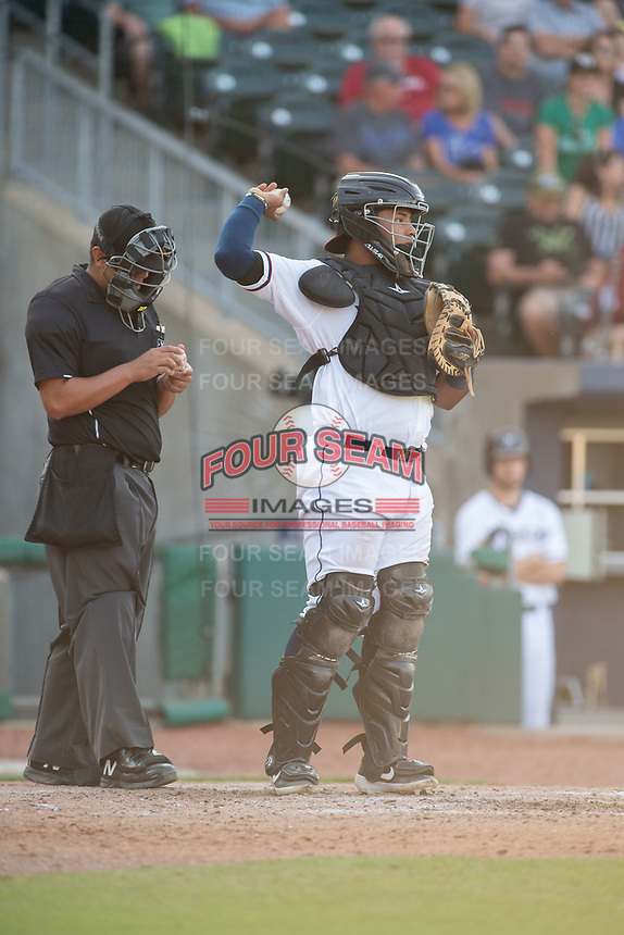 Northwest Arkansas Naturals catcher Meibrys Viloria (22) throws back to the mound during a Texas League game between the Northwest Arkansas Naturals and the Arkansas Travelers on May 30, 2019 at Arvest Ballpark in Springdale, Arkansas. (Jason Ivester/Four Seam Images)