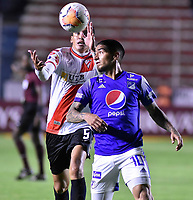 LA PAZ- BOLIVIA, 20-02-2020: Marcos Barrera de Club Always Ready y Cristian Arango de Millonarios disputan el balón durante partido entre Club Always Ready (BOL) y Millonarios (COL) por la Copa Conmebol Sudamericana 2020, jugado en el estadio Hernando Siles de la ciudad de La Paz. / Marcos Barrera of Club Always Ready and Cristian Arango of Millonarios vie for the ball during a match between Club Always Ready (BOL) and Millonarios (COL), for the Copa Conmebol Sudamericana 2020 at the Hernando Siles stadium in La Paz city. / Photo: VizzorImage / Daniel Miranda / Agencia de Prensa Grafica / Cont.