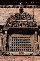 Kathmandu, Nepal.  Wood Carving above a Windowr in the Kumari Bahal, House of the Kumari Devi, a Young Girl Revered as a Living Goddess.  The wood used is sal wood, shorea robusta.  The house was constructed in 1757.