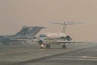 - airport of Milan Linate, Alitalia airplane MD 80 with fog....- aeroporto di Milano Linate, aereo Alitalia MD 80 con nebbia