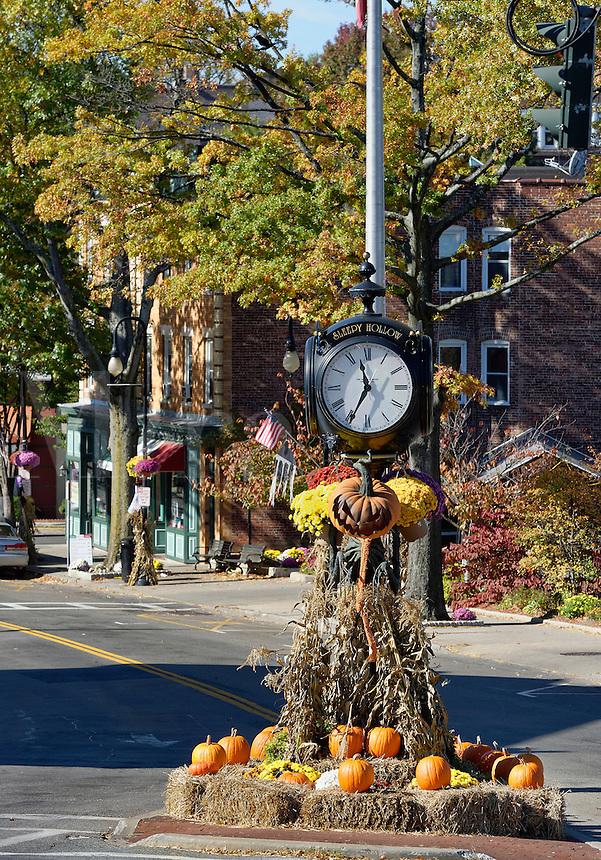 Town clock with autumn decorations, Sleepy Hollow, New York, USA