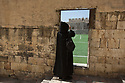 Jerusalem - Father Columba photographs the Armenian Monastery football field. The St. James compound houses around 4,000 ancient Armenian manuscripts, a collection which is second only to that in the Armenian capital Yerevan in terms of numbers and relevance.