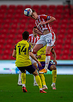 21st November 2020; Bet365 Stadium, Stoke, Staffordshire, England; English Football League Championship Football, Stoke City versus Huddersfield Town; Sam Clucas of Stoke City wins a clearing header