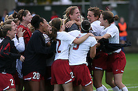 18 November 2007: Mimi Yuhas, Kate Mannino, Kira Maker, Austinn Freeman, Allison McCann, Ali Riley, Lizzy George and Kelley O'Hara congratulate Allison Falk during Stanford's 1-1 double overtime shootout win over California in the second round of the NCAA Division 1 Women's Soccer Championships at Laird Q. Cagan Stadium in Stanford, CA.
