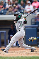 Dayton Dragons shortstop Hector Vargas (27) follows through on his swing against the West Michigan Whitecaps on April 24, 2016 at Fifth Third Ballpark in Comstock, Michigan. Dayton defeated West Michigan 4-3. (Andrew Woolley/Four Seam Images)