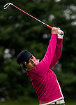 Yue-Xia Lu of China plays a shot during the Hyundai China Ladies Open 2014 on December 12 2014 at Mission Hills Shenzhen, in Shenzhen, China. Photo by Li Man Yuen / Power Sport Images