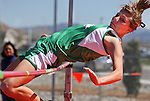 A Greenwave high-jumper competes in the Big George Invitational Track Meet on Friday, April 29, 2011, at Douglas High School in Minden, Nev. .Photo by Cathleen Allison