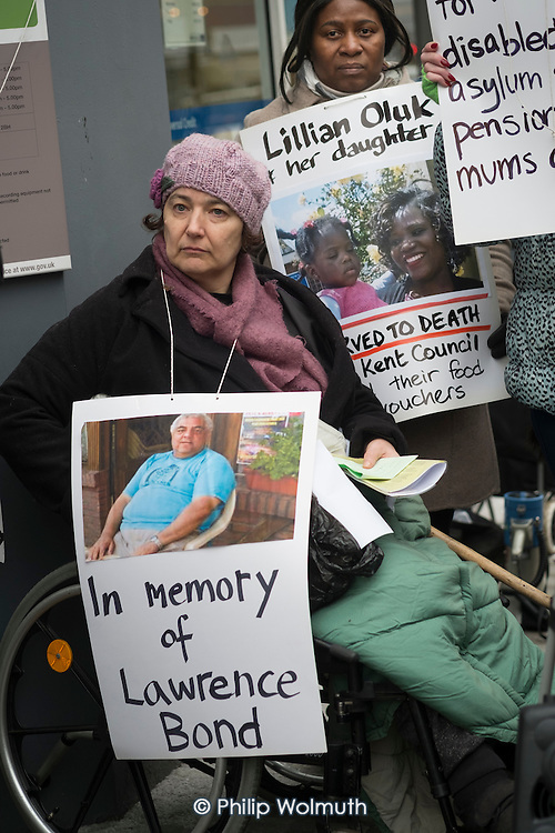 Clare Glasman. Vigil for Lawrence Bond, who died after being found fit for work and losing his disability benefits, Kentish Town Jobcentre London.