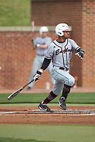 Carter Williams (1) of the North Carolina Central Eagles follows through on his swing against the High Point Panthers at Williard Stadium on February 28, 2017 in High Point, North Carolina. The Eagles defeated the Panthers 11-5. (Brian Westerholt/Four Seam Images)