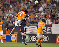 Houston Dynamo midfielder Lovel Palmer (22) and New England Revolution defender Pat Phelan (28) battle for head ball. The New England Revolution defeated Houston Dynamo, 1-0, at Gillette Stadium on August 14, 2010.
