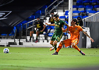 LAKE BUENA VISTA, FL - JULY 18: Diego Valeri #8 of the Portland Timbers has the ball pushed away by Zarek Valentin #4 of the Houston Dynamo during a game between Houston Dynamo and Portland Timbers at ESPN Wide World of Sports on July 18, 2020 in Lake Buena Vista, Florida.