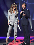 Jennifer Lopez and Ryan Seacrest  at The AMERICAN IDOL Season Ten judges' panel Announcement held at The Forum in Los Angeles, California on September 22,2010                                                                               © 2010 Hollywood Press Agency
