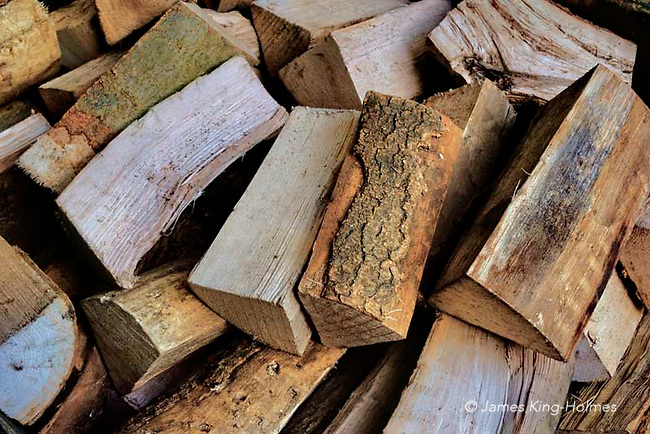 Logs of wood chopped to feed the open fir at the George Hotel, Stamford, Lincolnshire.The Hotel, which dates from medieval times, vecame a foremost coaching inn in the 18th Century and maintains open fires as part of the welcoming atmosphere.
