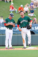 First baseman Sam Travis (28) of the Greenville Drive speaks with manager Darren Fenster while standing on third base in a game against the Rome Braves on Sunday, August 3, 2014, at Fluor Field at the West End in Greenville, South Carolina. Travis is a second-round pick of the Boston Red Sox in the 2014 First-Year Player Draft out of Indiana University. Rome won, 4-2. (Tom Priddy/Four Seam Images)