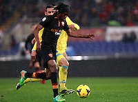 Calcio, semifinale di andata di Coppa Italia: Roma vs Napoli. Roma, stadio Olimpico, 5 febbraio 2014.<br /> AS Roma forward Gervinho, of Ivory Coast, foreground, runs on his way to score the winning goal as Napoli defender Faouzi Ghoulam, of France, challenges him during the Italian Cup first leg semifinal football match between AS Roma and Napoli at Rome's Olympic stadium, 5 February 2014. AS Roma won 3-2.<br /> UPDATE IMAGES PRESS/Isabella Bonotto