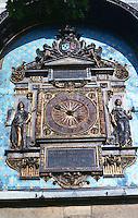Visual Arts: Paris-- Conciergerie--Tour de L'Horloge, 1370.  The first public clock installed in Paris.  The carvings on the face, 16th century.  Photo '90.