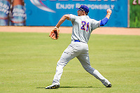 Midland RockHounds outfielder Matt Olson (21) makes a throw to the infield during the Texas League baseball game against the San Antonio Missions on June 28, 2015 at Nelson Wolff Stadium in San Antonio, Texas. The Missions defeated the RockHounds 7-2. (Andrew Woolley/Four Seam Images)